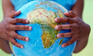 Close up of girl s hands holding globe