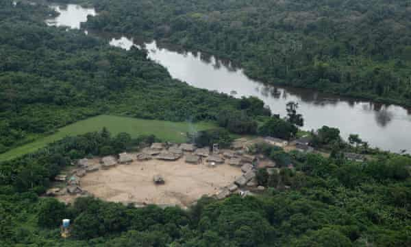 An aerial view of the Bacaja indigenous tribe, of Chicrin ethnicity, on the Bacaja river banks, an affluent of the Xingu river, 220 km (137 miles) outside Altamira, northern Brazil April 29, 2010. After nearly three decades of sometimes violent protests, about 1,000 other indigenous people in the remote region have resigned themselves to the fact that the world's third-largest dam will be built in their backyard. Supporters say the Belo Monte dam will create jobs in a downtrodden region and help power Latin America's largest economy but critics say the race for economic prosperity also brings social and environmental costs.