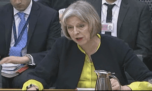 Theresa May speaking at the home affairs committee