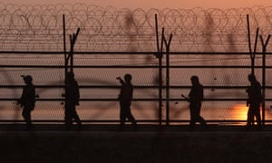 South Korean soldiers patrol inside the barbed-wire fence near the border village of Panmunjom in the demilitarised zone that separates North and South.