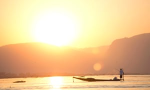 The sun sets over fishermen on Inle Lake. This is one of the final photographs Angus McDonald ever took in Burma.