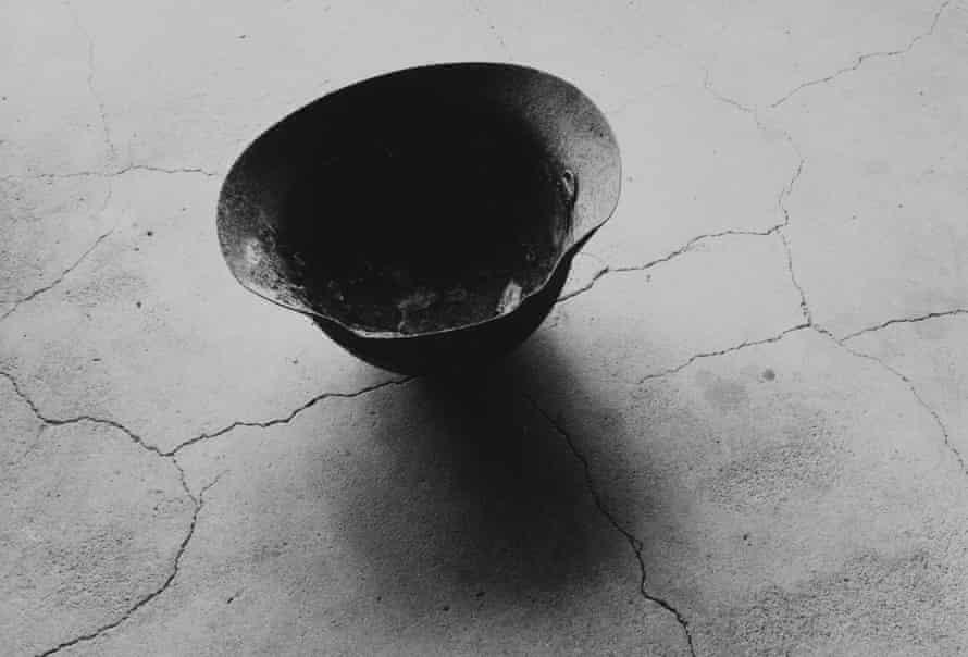 Steel Helmet with Skull Bone Fused by Atomic Bomb, Nagasaki 1963, by Shomei Tomatsu