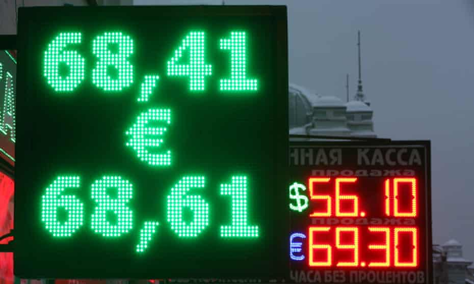 A board in Moscow shows the exchange rates for the rouble.