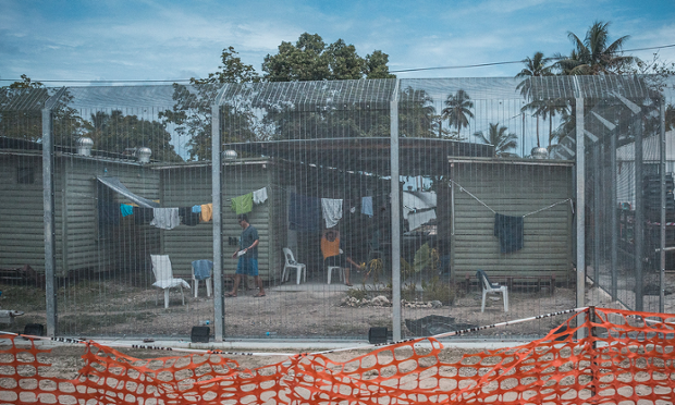 Asylum seekers in front of their housing units at the Manus Island Regional Processing Centre at Lombrum.
