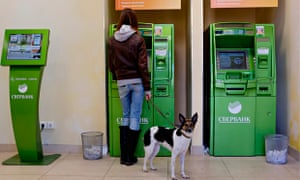 Woman withdrawing cash Russia