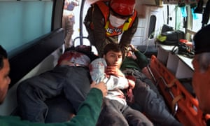 Pakistani rescue workers take students injured in the shootout to hospital.