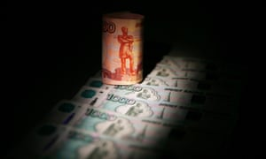 The rouble hit a new record low against the euro and dollar on Tuesday.