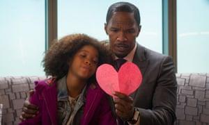 Have a heart ... Quvenzhane Wallis as Annie, and Jamie Foxx as Will Stacks,