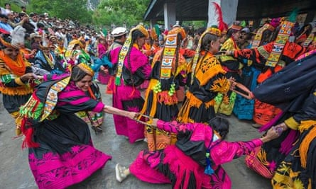 Kalash women and girls dancing wildly, Chitral, Khyber-Pakhtunkhwa, Pakistan