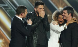 Ben Haenow celebrates on stage after The X Factor final on Sunday