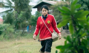Alisa Xaysithideth walks to the youth health clinic near her village in the Kaisone district.