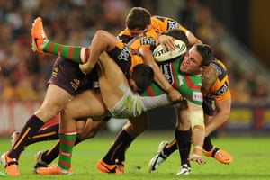 25 April: Sam Burgess of the Rabbitohs is tackled during an NRL match between the Brisbane Broncos and the South Sydney Rabbitohs at Suncorp Stadium in Brisbane, Australia.