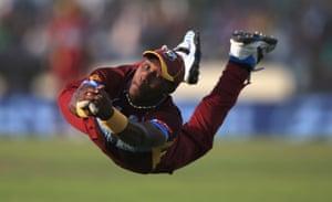 March 28: Dwayne Bravo of the West Indies catches James Faulkner of Australia off the bowling of Krishmar Santokie during their ICC World Twenty20 match in Dhaka, Bangladesh