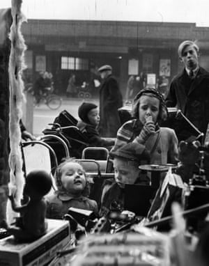 A group of children look through a toy shop window in Dagenham