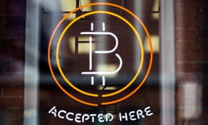 A Bitcoin sign is seen in a window in Toronto, in this file photo from May 8, 2014.
