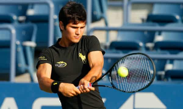 Marcos Giron demonstrates the Raph Lauren smartshirt during a closed session at the 2014 US Open in New York.