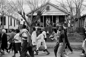 Selma marchers passing by houses. Selma to Montgomery, Alabama civil rights march. 25 March 1965