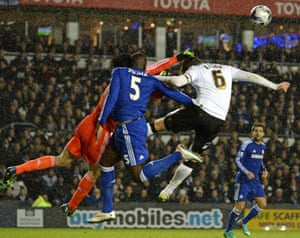 Kurt Zouma clashes heads with Petr Cech whilst under pressure from Derby's Richard Keogh.