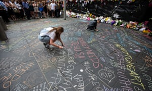 Phoebe Finlayson, left, took chalk to Martin Place and within an hour scores of people had left their marks alongside her original #illridewithyou message