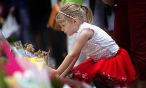 Ava Johnson from Sydney leaves flowers.