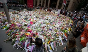 The queue to lay flowers at in Martin Place stretched for many hundreds of metres