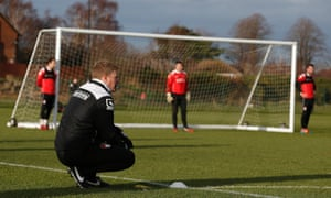 Howe watches on during a training session.