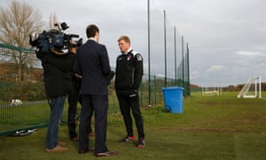 Howe takes time out to give a TV interview