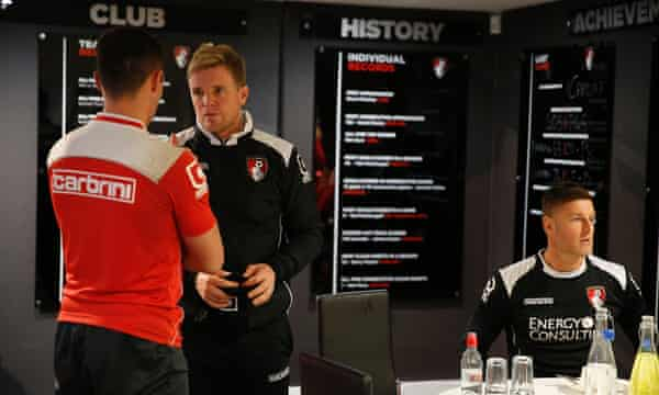 Howe talks to goalkeeper Darryl Flahaven in the players' room at the Goldsands.