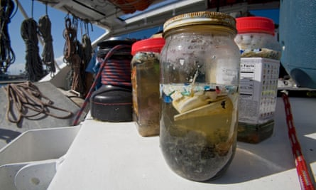 Plastic sample jars. The ORV Alguita returns to Long beach after four months at sea sampling the waters of the great Pacific garbage patch' in the North Pacific Subtropical Gyre (NPSG). The Algalita Marine Research Foundation has been studying and educating the public about the effects of oceanic micro-plastic pollution on the ocean's ecosystem and marine life for over ten years. Long Beach, California, USA.