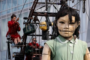 The Little Giant Girl walks through Liverpool as part of Liverpool's first world war centenary commemorations