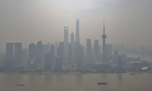 A general view of Pudong Lujiazui Financial District in heavy smog is seen on October 16, 2014 in Shanghai, China. A report from Shanghai Environmental Monitoring Center said that the AQI (Air Quality Index) reached to high 211 in the morning which is serious pollution and fell to 178 in the afternoon to moderate pollution.