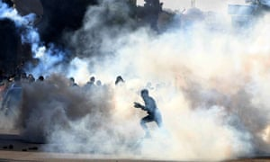 Supporters of the ousted president Mohamed Morsi clash with security forces near Cairo University earlier this year.