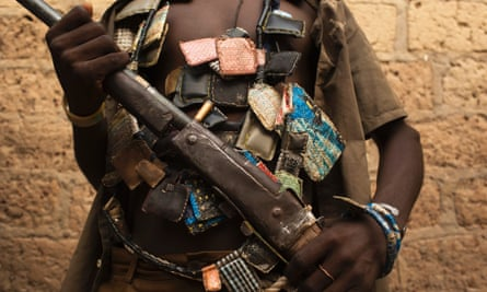 A member of the anti-balaka militia poses for a photograph on the outskirts of the capital, Bangui, in January