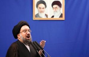 Iranian senior hard-line cleric Ayatollah Ahmad Khatami, delivers a Friday prayer sermon, under the pictures of late revolutionary founder Ayatollah Khomeini, left, and supreme leader Ayatollah Ali Khamenei, at the Tehran University campus in Tehran, Iran, Friday, June 26, 2009.