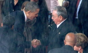 Barack Obama shakes hands with Cuban president Raul Castro during Nelson Mandela's memorial service in December 2013.