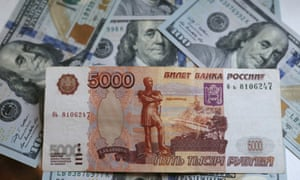 Russian rouble banknote and US dollars.
