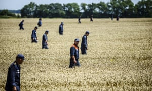 Donetsk, Ukraine  26 July: Members of the  Ukrainian State Emergency Service search for bodies in a field near the crash site of the Malaysia Airlines Flight MH17 near the village of Grabove