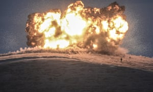 <strong>Sanliurfa, Turkey </strong><br>Islamic State militants stand during the explosion of an air strike on Tilsehir hill near the Turkish border at Yumurtalik village