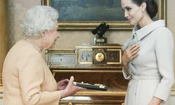 Angelina Jolie meets the Queen.