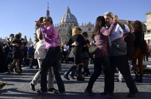 Tango enthusiasts dance on the Via della Conciliazione in front of St Peter's Square. The pontiff joked: 'It looks like a two-by-four' – a reference to the tango