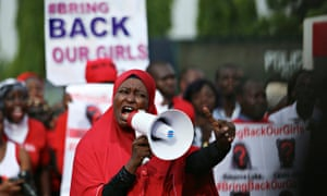 Protesters march to the Nigerian presidential villa.