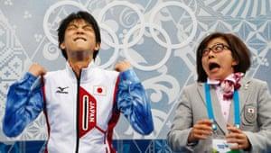 13 February: Japan's Yuzuru Hanyu and his figure-skating coach Yoshiko Kobayashi reacted with delight during the Figure Skating Men's Short Program at the Sochi 2014 Winter Olympics