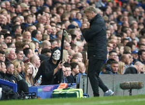 <strong>20 April:</strong> Beleaguered Manchester United manager David Moyes is mocked by a man dressed as the Grim Reaper at Goodison Park
