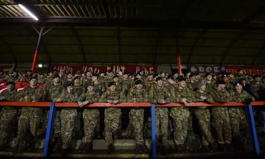 Members of the British armed forces watch the Game of Truce in Aldershot.