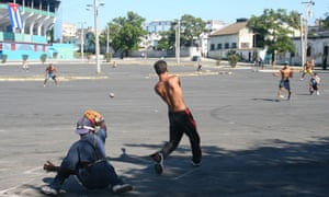 Cuban youths play baseball outside the Estadio Latinoamericano. The sport runs deep in Cuba, one reason why MLB would love to re-establish business relations with the island nation