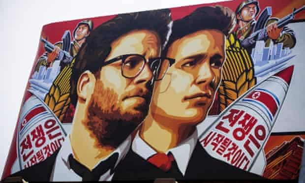 A banner for 'The Interview' is posted outside Arclight Cinemas.