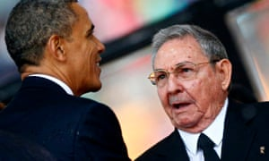 Obama greets Raul Castro at tNelson Mandeal memorial