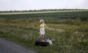 An Ukrainian girl cries as she stands on the road with her luggage after she left her home near the village of Hrabove (Grabovo), some 80km east of Donetsk on August 2, 2014. The insurgent stronghold of Lugansk in eastern Ukraine is on the verge a humanitarian catastrophe, the mayor warned Saturday, as a siege by government troops has seen water, electricity and food supplies cut off.
