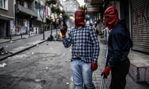 <strong>Istanbul, Turkey</strong><br>23 May: Militants of the Revolutionary People's Liberation Party-Front stand in the street with guns during a demonstration after the funeral of a protester who was killed