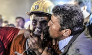 <strong>Manisa, Turkey</strong><br>13 May: A man kisses his son after he was rescued from a collapsed coal mine. At least 157 miners were killed in collapsed coal mine